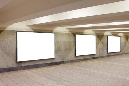 Three blank billboard advertisement posters on underground wall. 3d illustration Stock Photo
