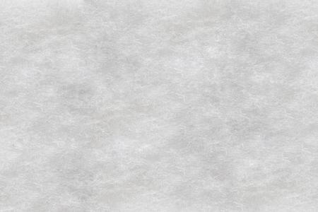White nonwoven synthetic textilel, sintepon texture.