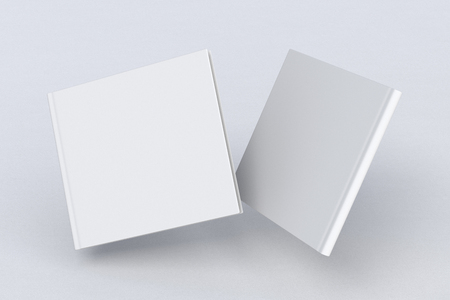 White square two blank book cover flying over white background. Front and back cover views. 3d illustration Banco de Imagens