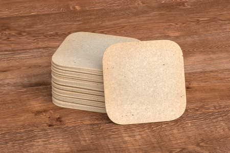 Vintage square beer coasters on wooden background  around coasters. 3d illustration Stockfoto