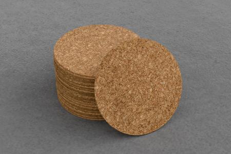 Cork round beer coasters on gray background around coasters. 3d illustration Stockfoto