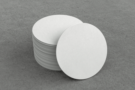 White round beer coasters on gray background around coasters. 3d illustration