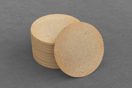 Vintage round beer coasters on gray background around coasters. 3d illustration Stock fotó - 103915679