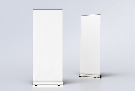 Two blank roll up banner display stands on white background, include clipping path around banner poster. 3d render Banco de Imagens