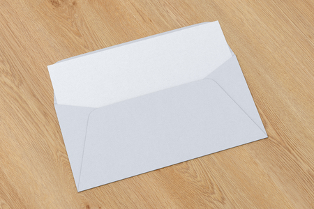 White blank envelope with blank letter inside on wooden background. 3d render Фото со стока