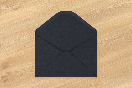 Black blank envelope on wooden background. 3d render