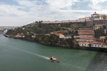 Porto, Portugal. Cityscape of  Douro river and Mosteiro da Serra do Pilar from Ponte Luis I bridge.