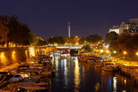 PARIS, FRANCE - View from of Bassin de lArsenal to Place de la Bastille at night.
