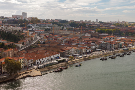 Porto, Portugal. Cityscape of south part of town, Douro river and port winery and warehouses from Ponte Luis I bridge. Imagens