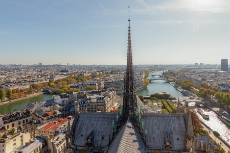 View on Paris with spire of the cathedral and the river Seine form Notre Dame cathedral. Paris, France