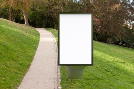 Blank street billboard poster stand in the park. 3d illustration. Reklamní fotografie