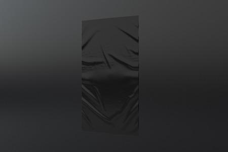 Blank black vertical wrinkled street poster on black wall. Imagens
