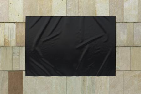 Blank black horizontal wrinkled street poster on marble tiles wall. Banco de Imagens
