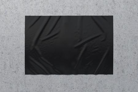 Blank black horizontal wrinkled street poster on concrete wall. Imagens