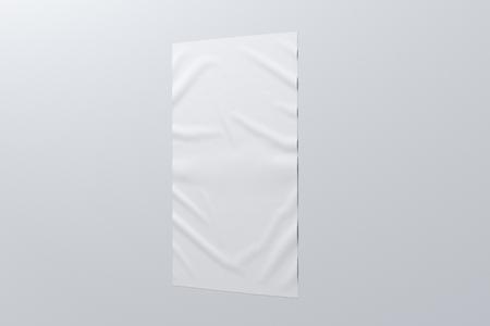 Blank vertical wrinkled street poster on white wall.