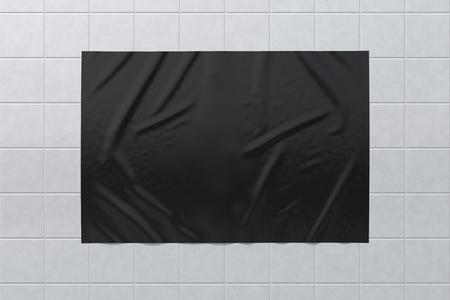 Blank black horizontal wrinkled street poster on glazed tiles wall. Stockfoto
