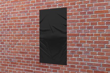 Blank black vertical wrinkled street poster on brick wall.