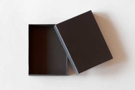 Open blank black carton box packaging isolated on white background. View above.