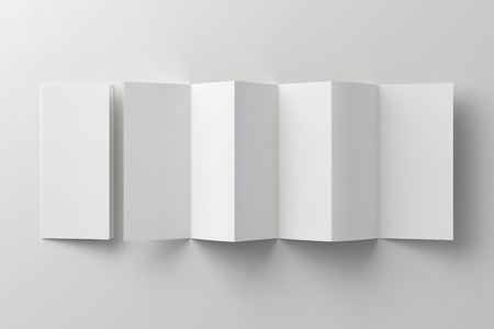 Blank six fold, twelve pages brochure booklet on white background. 3D illustration Фото со стока