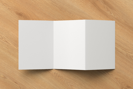 Blank unfolded trifold of three of A5/A4 pages brochure booklet on wooden background . 3D illustration