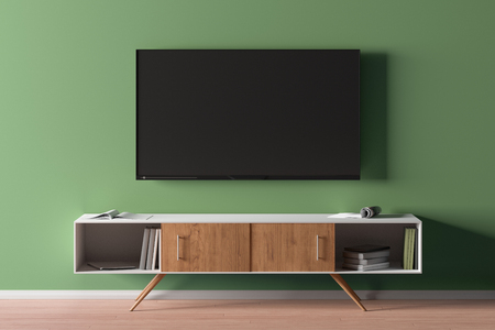 TV screen on green wall above the TV cabinet in modern living room  background. 3d illustration 写真素材