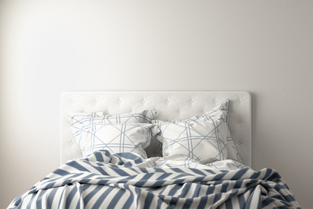 Top of unmade bed with duvet, bedding and pillows isolated on white. Front view. 3d render