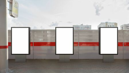 Three blank street billboard poster stands mock up on platform of railway station. 3d illustration.
