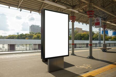 Blank billboard poster stand mock up on platform of railway station. 3d illustration. Banco de Imagens