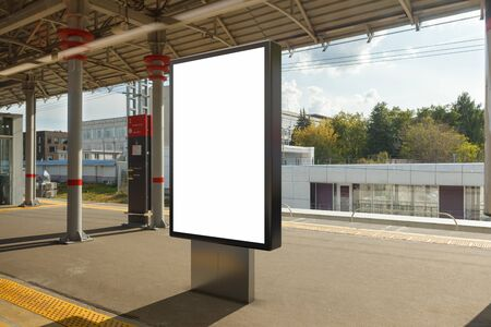Blank billboard poster stand mock up on platform of railway station. 3d illustration. Stock Illustration - 129677804