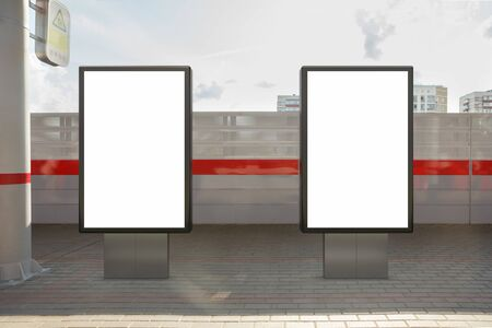 Two blank billboard poster stands mock up on platform of railway station. 3d illustration. Stock Illustration - 129677834