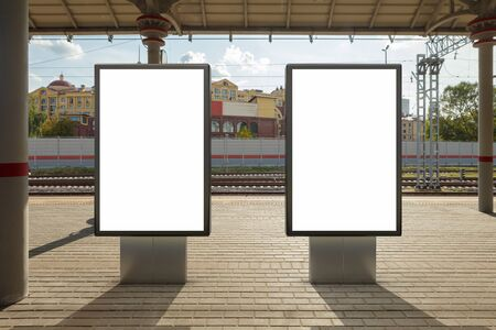 Two blank billboard poster stands mock up on platform of raillway station. 3d illustration. Stock Illustration - 129677859