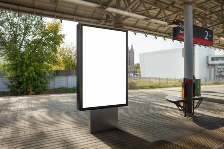 Blank billboard poster stand mock up on platform of raillway station. 3d illustration. Banco de Imagens