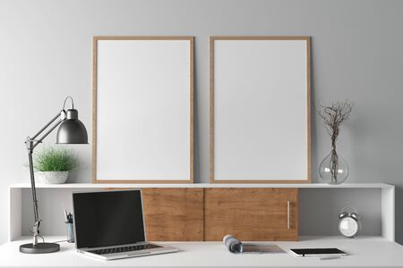 Workspace with two vertical poster mock ups on the desk. Desk with drawers in interior of the studio or at home with white wall. 3d illustration.