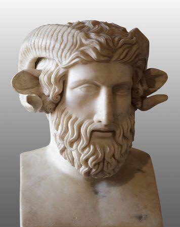 Ancient marble head of Zeus-Ammon. Isolated