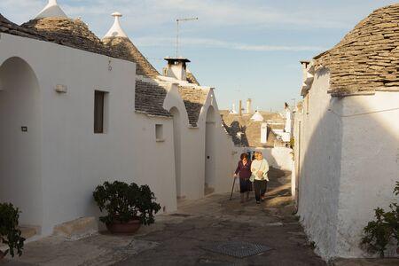 Alberobello, street with trulli (trullo) houses. Italy
