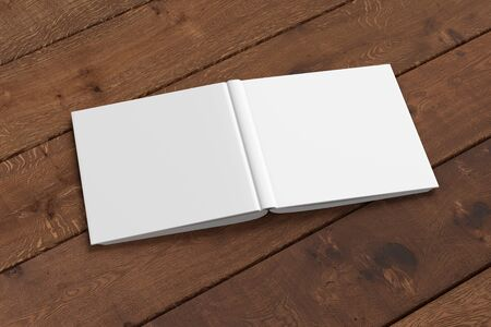 Blank white square open and upside down book cover on wooden boards