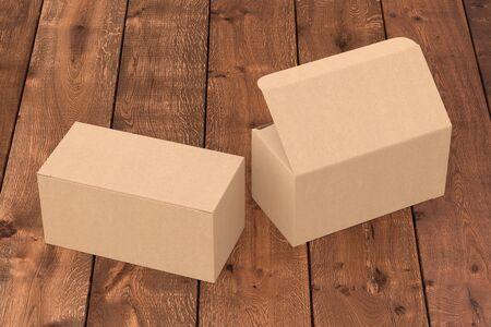 Blank cardboard wide box with open and closed hinged flap lid on dark wooden background. 3d illustration Zdjęcie Seryjne