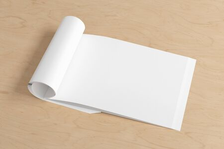 Blank horizontal right magazine page. Workspace with folded magazine mock up on wooden desk. Side view. 3d illustration