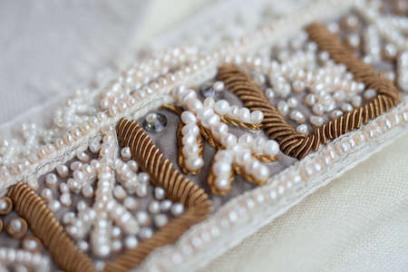 Embroidery of a traditional russian headdress in the technique of pearl sewing. Stockfoto