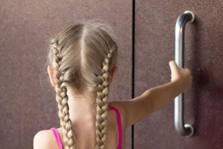 Girl open steel door