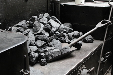 Coal and shovel in old vintage steam train 7286