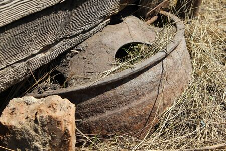 mot: Rusty wheel disk in the yard 19667