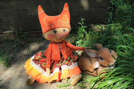 Russian homemade rag doll as symbol of autumn