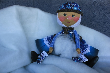 Russian homemade rag doll as symbol of winter
