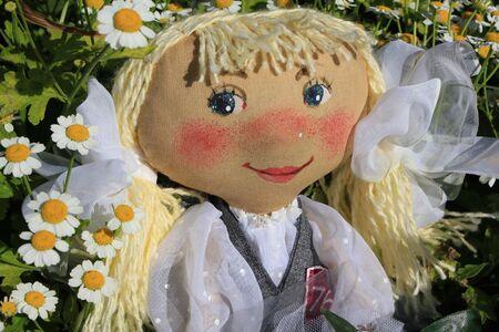 muñecas rusas: Rusia muñeca de trapo hecha en casa como símbolo de la colegiala
