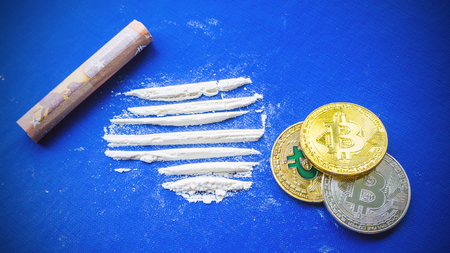 Bitcoina - digital cryptocurrency and euro on a blue background golden bitcoins with the spotlight. The white powder with money. Bitcoina - digital cryptocurrency and euro on a blue background golden Stock Photo - 105348204