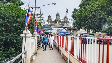 POIPET, CAMBODIA -  NOVEMBER 24, 2017: The border crossing between Thailand and Cambodia. Thailand Cambodia border when traveling overland between Bangkok and Siem Reap. Unidentified people