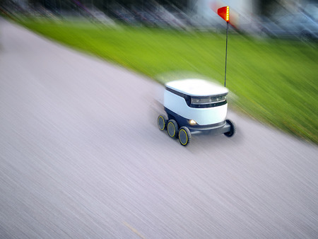 Estonian delivery robots on the street. cyber-couriers are already cruising the sidewalks in Estonia (Tallinn) are cruising the sidewalks 版權商用圖片