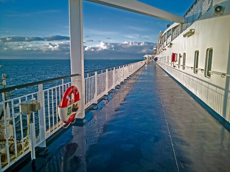 TALLINN, ESTONIA - JULY 7, 2018: red Lifebuoy and sea-view of Baltic sea with cruise lainer. The ferry Viking Line. Paromy of regular flights between Helsinki and Tallinn . Blue sky on the background