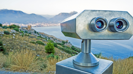 Coin Operated Binocular viewer next to the waterside promenade in Antalya the Bay and city. Observation deck - binocular with  telescope Turkey. Concept of travel and tourism. Beautiful panorama Imagens